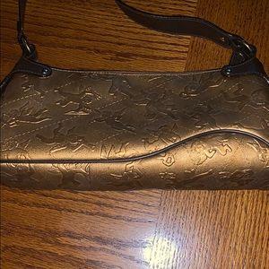 Piero Guidi gold cherub handbag 👜
